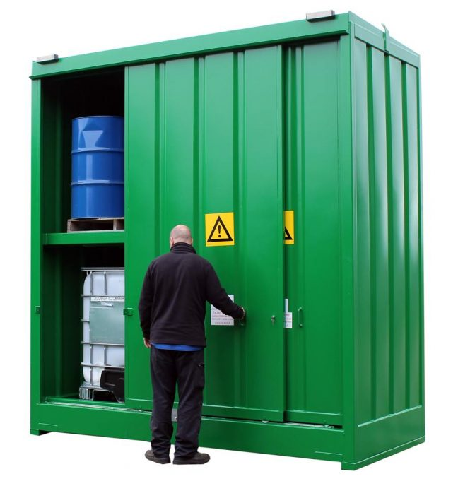 DPU16 4 Store filled with Drums and IBCs with man working the sliding door